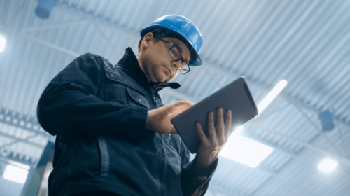 worker using tablet in factory